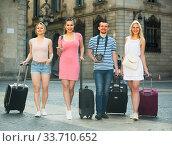 Купить «four tourists taking walk», фото № 33710652, снято 4 июля 2020 г. (c) Яков Филимонов / Фотобанк Лори