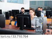 Купить «Female and male students working on computers», фото № 33710764, снято 25 мая 2020 г. (c) Яков Филимонов / Фотобанк Лори