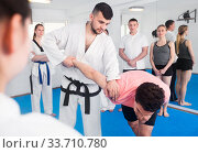 Купить «Coach showing new submission hold in taekwondo class», фото № 33710780, снято 8 апреля 2017 г. (c) Яков Филимонов / Фотобанк Лори