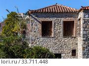 Купить «The old, stone house close-up», фото № 33711448, снято 12 марта 2020 г. (c) Татьяна Ляпи / Фотобанк Лори