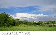 Купить «Beautiful summer rural landscape with cloudy sky», видеоролик № 33711700, снято 18 июля 2018 г. (c) Володина Ольга / Фотобанк Лори