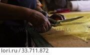 Купить «Mixed race woman working at a hat factory», видеоролик № 33711872, снято 16 мая 2019 г. (c) Wavebreak Media / Фотобанк Лори