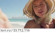 Купить «Caucasian woman sending kisses through camera at beach», видеоролик № 33712116, снято 25 февраля 2020 г. (c) Wavebreak Media / Фотобанк Лори