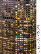 Купить «Late Working urban concept, window facade of business center office building at night, New York city NY USA.», фото № 33715048, снято 16 июля 2020 г. (c) easy Fotostock / Фотобанк Лори