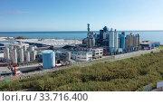 Купить «Aerial panoramic view of chemical process plant on Mediterranean coast near Mataro, Catalonia, Spain», видеоролик № 33716400, снято 24 ноября 2019 г. (c) Яков Филимонов / Фотобанк Лори