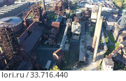 Купить «View from drone of old abandoned blast furnaces of Vitkovice Iron and Steel Works, Ostrava city, Czech Republic», видеоролик № 33716440, снято 17 октября 2019 г. (c) Яков Филимонов / Фотобанк Лори