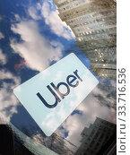 Купить «Moscow, Russia - Apr 26.2020. Uber taxi logo on a car windshield», фото № 33716536, снято 26 апреля 2020 г. (c) Володина Ольга / Фотобанк Лори
