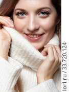 Купить «Blonde young beautiful woman dressed in white woolen sweater .», фото № 33720124, снято 4 декабря 2019 г. (c) Serg Zastavkin / Фотобанк Лори
