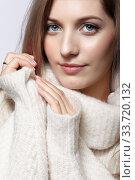 Купить «Blonde young beautiful woman dressed in white woolen sweater .», фото № 33720132, снято 4 декабря 2019 г. (c) Serg Zastavkin / Фотобанк Лори