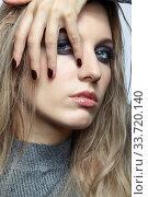 Купить «Blonde young beautiful woman dressed in white woolen sweater.», фото № 33720140, снято 4 декабря 2019 г. (c) Serg Zastavkin / Фотобанк Лори