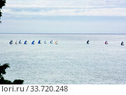 Купить «A group of sailboats sailing in the Black Sea in backlight», фото № 33720248, снято 9 октября 2019 г. (c) Александр Карпенко / Фотобанк Лори