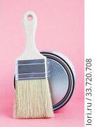 Купить «Paint metal round can and new brush on pink background. Focus on brush. House renovation. Hobby.», фото № 33720708, снято 3 мая 2020 г. (c) Papoyan Irina / Фотобанк Лори