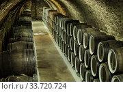 Купить «barrel filled with wine in wine cellar», фото № 33720724, снято 10 августа 2019 г. (c) Михаил Коханчиков / Фотобанк Лори