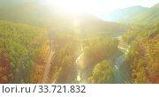 Купить «Low altitude flight over fresh fast mountain river with rocks at sunny summer morning.», видеоролик № 33721832, снято 6 апреля 2019 г. (c) Александр Маркин / Фотобанк Лори