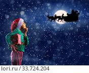 Купить «Thoughtful boy and Santa Claus sledge over moon», фото № 33724204, снято 30 января 2019 г. (c) Сергей Новиков / Фотобанк Лори