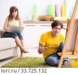 Купить «Young couple enjoying painting at home», фото № 33725132, снято 11 июля 2018 г. (c) Elnur / Фотобанк Лори