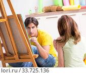 Купить «Young couple enjoying painting at home», фото № 33725136, снято 11 июля 2018 г. (c) Elnur / Фотобанк Лори
