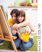 Купить «Young couple enjoying painting at home», фото № 33725140, снято 11 июля 2018 г. (c) Elnur / Фотобанк Лори