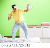 Купить «Young man with virtual glasses in the bedroom», фото № 33726012, снято 22 июня 2018 г. (c) Elnur / Фотобанк Лори