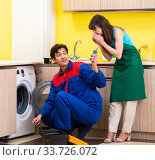 Купить «Contractor repairing washing machine at home», фото № 33726072, снято 20 июня 2018 г. (c) Elnur / Фотобанк Лори