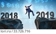 Businessman balancing between 2018 and the 2018. Стоковое фото, фотограф Elnur / Фотобанк Лори