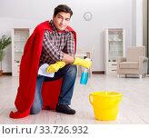 Купить «Super hero husband cleaning floor at home», фото № 33726932, снято 26 декабря 2016 г. (c) Elnur / Фотобанк Лори