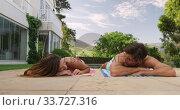 Купить «Happy Caucasian couple enjoying the pool during a sunny day», видеоролик № 33727316, снято 28 ноября 2019 г. (c) Wavebreak Media / Фотобанк Лори