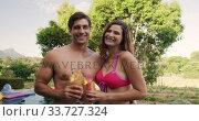 Купить «Happy Caucasian couple drinking cocktails during a sunny day», видеоролик № 33727324, снято 28 ноября 2019 г. (c) Wavebreak Media / Фотобанк Лори