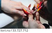 Купить «Doing manicure in the salon - applying base on the nail», видеоролик № 33727712, снято 3 июля 2020 г. (c) Константин Шишкин / Фотобанк Лори