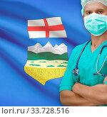 Купить «Surgeon with Canadian province flag on background - Alberta», фото № 33728516, снято 11 июля 2020 г. (c) age Fotostock / Фотобанк Лори