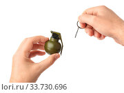 Купить «Hand pulls a check from a grenade isolated on white background», фото № 33730696, снято 10 июля 2020 г. (c) easy Fotostock / Фотобанк Лори