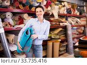Купить «Female touching and choosing carpets», фото № 33735416, снято 22 ноября 2017 г. (c) Яков Филимонов / Фотобанк Лори