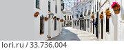 Empty street of Mijas village panoramic image. Costa del Sol, Malaga. Spain. Стоковое фото, фотограф Alexander Tihonovs / Фотобанк Лори