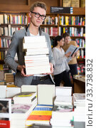man with stack of textbooks in hands. Стоковое фото, фотограф Яков Филимонов / Фотобанк Лори