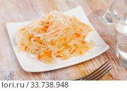 Купить «Sauerkraut with carrots in bowl on the table», фото № 33738948, снято 2 июня 2020 г. (c) Яков Филимонов / Фотобанк Лори