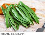 Купить «Fresh green beans on wooden background», фото № 33738964, снято 26 мая 2020 г. (c) Яков Филимонов / Фотобанк Лори