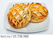 Купить «Tasty bakery pastries with goat cheese and and spinach», фото № 33738988, снято 27 мая 2020 г. (c) Яков Филимонов / Фотобанк Лори