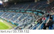 Купить «Зрители на трибунах стадиона, размыто», видеоролик № 33739132, снято 19 марта 2020 г. (c) Кекяляйнен Андрей / Фотобанк Лори