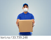 Купить «indian delivery man with parcel box in respirator», фото № 33739248, снято 12 января 2019 г. (c) Syda Productions / Фотобанк Лори