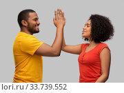 Купить «happy african american couple making high five», фото № 33739552, снято 15 декабря 2019 г. (c) Syda Productions / Фотобанк Лори