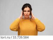 Купить «serious woman closing ears with hands», фото № 33739584, снято 20 марта 2020 г. (c) Syda Productions / Фотобанк Лори