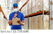 Купить «delivery man in face protective mask at warehouse», фото № 33739648, снято 12 января 2019 г. (c) Syda Productions / Фотобанк Лори