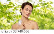 Купить «beautiful woman with feather touching her face», фото № 33740056, снято 30 ноября 2019 г. (c) Syda Productions / Фотобанк Лори