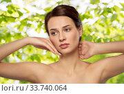 Купить «beautiful young woman touching her face», фото № 33740064, снято 30 ноября 2019 г. (c) Syda Productions / Фотобанк Лори