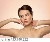 Купить «beautiful young woman touching her face», фото № 33740232, снято 30 ноября 2019 г. (c) Syda Productions / Фотобанк Лори