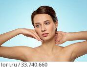 Купить «beautiful young woman touching her face», фото № 33740660, снято 30 ноября 2019 г. (c) Syda Productions / Фотобанк Лори