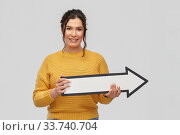 Купить «smiling young woman with big white right arrow», фото № 33740704, снято 20 марта 2020 г. (c) Syda Productions / Фотобанк Лори