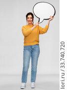 Купить «smiling young woman holding big speech bubble», фото № 33740720, снято 20 марта 2020 г. (c) Syda Productions / Фотобанк Лори
