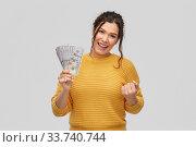 Купить «happy smiling young woman with dollar money», фото № 33740744, снято 20 марта 2020 г. (c) Syda Productions / Фотобанк Лори