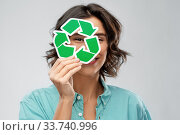 smiling woman looking through green recycling sign. Стоковое фото, фотограф Syda Productions / Фотобанк Лори
